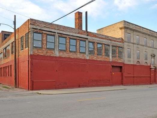 A former garage on Temple near Cass is one of three