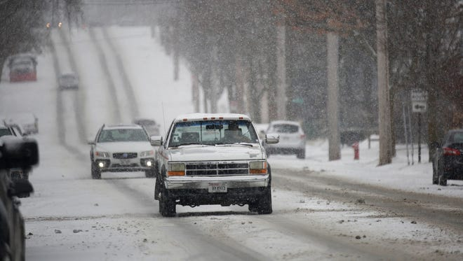 Trucks and all-wheel vehicles were out in abundance along South 8th Street, Saturday, February 3, 2018 in Sheboygan, Wis.
