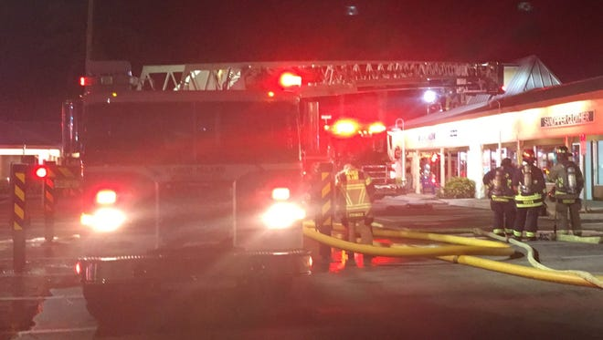 Firefighters and police officers respond to a fire at Marco Town Center on Marco Island, Fla., on March 7, 2018. The cause of the fire is unknown.
