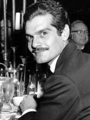AP Omar Sharif poses for a photo at a 1962 dinner party after the movie premiere of ?Lawrence of Arabia? in Hollywood.