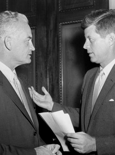 Sen. Barry Goldwater, R-Ariz., left, listens to Sen. John Kennedy D-Mass., on June 13, 1958. Kennedy was  floor manager for the labor control bill during its consideration by the U.S. Senate.  Goldwater called for plugging more loopholes to tighten union controls.