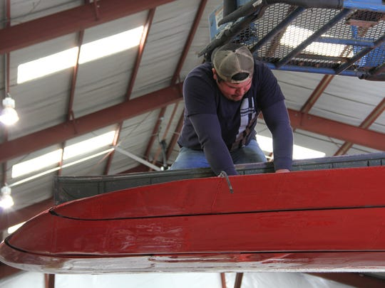 A Neptune Aviation Services mechanic conducts regular wing maintenance checks on the wing of a P2V airplane.