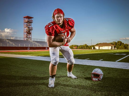 Center Grove's Clay Hadley, No. 71, on the Titan's home field at Center Grove High School after a scrimmage against Howe High School, Friday August 12th, 2016.