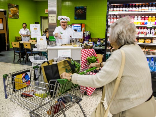 Food demonstrator Tricia Cogan offers samples of pork piccata to customers passing by at Publix in East Naples on Friday, Feb. 24, 2017. Cogan has been with Publix for four years and often dresses up to match the theme of whatever food she is serving that day.