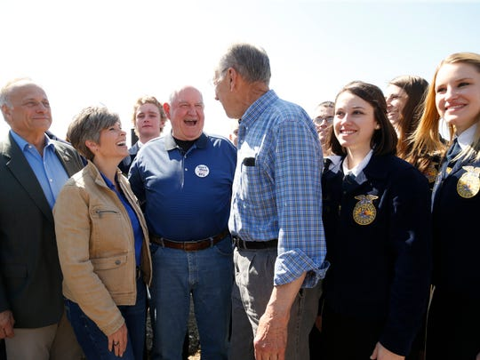U.S. Secretary of Agriculture Sonny Perdue (third from left) laughs after taking a group photo with congressional leaders Steve King, Joni Ernst, Chuck Grassley and members of the Nevada FFA Friday, May 5, 2017 during a visit to Couser Cattle Company in Nevada, Iowa.