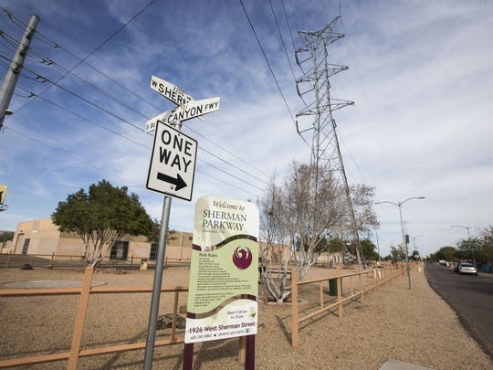 The city parks department says it can't plant many trees at Sherman Parkway because ofthe APS power lines above the park.