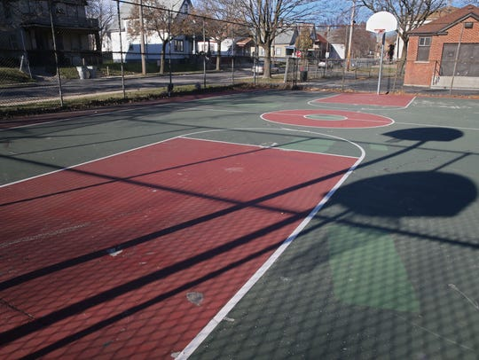 The basketball court is seen at the playground and