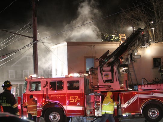 Bedford Hills firefighters work at the scene of a fire