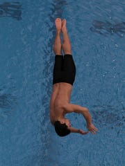 Ballard High School Jacob Lyons competes in the one meter diving at the 2018 KHSAA Boys State Swimming Championship at the Ralph Wright Natatorium in Louisville, Kentucky,       February 24,  2018.