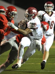 MBA's Ty Chandler weaves through traffic during the