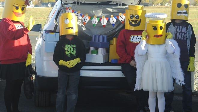 The Leonard family (from left: Sheena, Mason, Jacklyn, Cat and Noah) dressed up as Legoland characters.