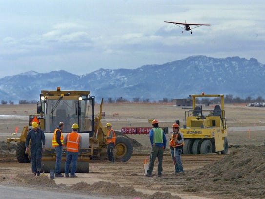 United Materials crews work on repaving a taxiway at