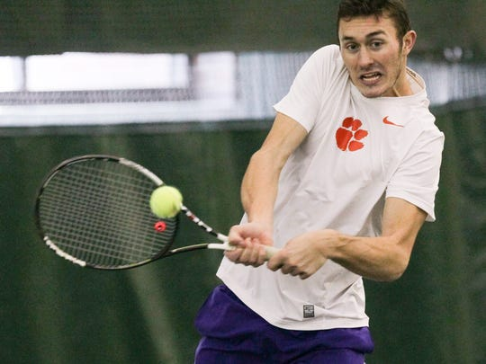 Clemson men's tennis player Alex Favrot returns a ball during practice in Clemson.
