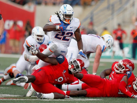 Boise State running back Alexander Mattison attempts