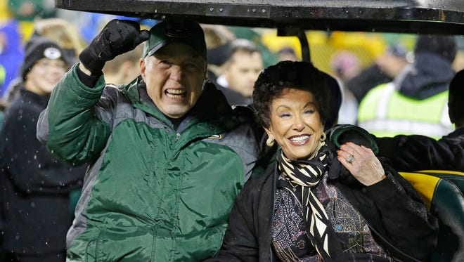 Bart Starr, left, and his wife Cherry enjoy the ovation for them as they are introduced at halftime at a Packers game in November.