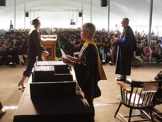 Graduates receive their diplomas at the Champlain College commencement Saturday in Burlington.