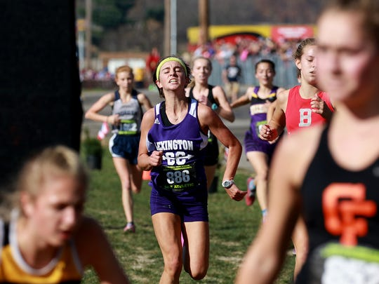 Alexia Smith of Lexington passes the last few runners in front of her before crossing the finish line in the girls Division II cross country state championship race.