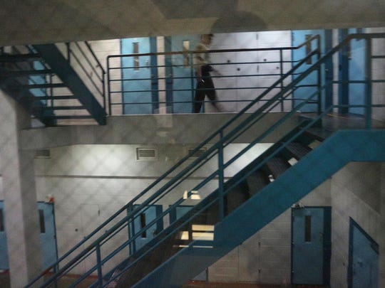In this file photo from March 2013, corrections officer Dan D'Acquistos helps clear C block before cells are searched at the Marathon County Jail.