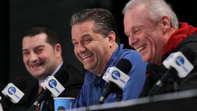 UK head coach John Calipari, center, shares a laugh with Wisconsin head coach Bo Ryan, right, as they spoke to the press ahead of their Final Four match up at the AT&T Stadium in Arlington, TX.  Moderator Mark Fratto was at left. Mar. 30, 2014