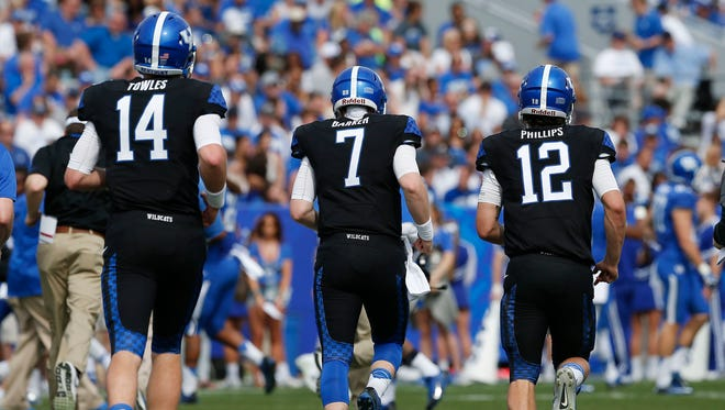 Kentucky Wildcats quarterbacks Patrick Towles (14), Drew Barker (7), Reese Phillips (12) took to the field during the first half the annual Blue White spring football game at Commonwealth Stadium in Lexington, Ky. April 26, 2014