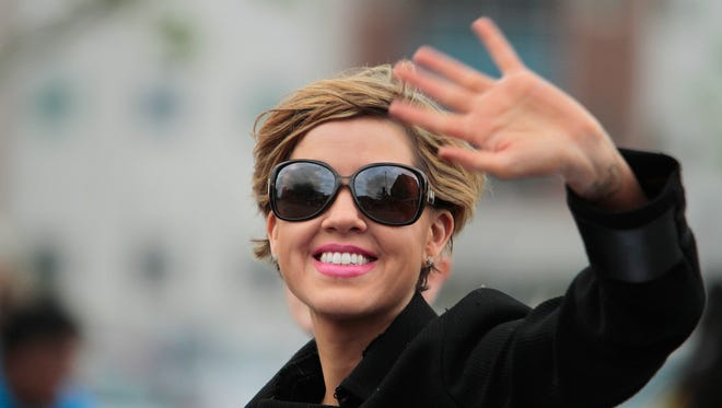Jill Conley participates in the 2014 Kentucky Derby Festival Pegasus Parade on Thursday evening in downtown Louisville. May 1, 2014.