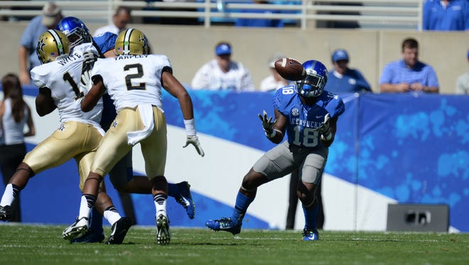UK running back Stanley Boom Williams pulls in a catch during the first half of the University of Kentucky Football game against the Vanderbilt Commodores in Lexington, KY. Saturday, September 27, 2014.