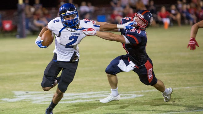Chandler running back Chase Lucas shakes off a Centennial defender during the Aug. 29, 2014, game in Peoria.