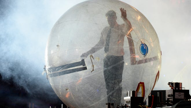 DJ/producer Diplo of Major Lazer prepares to surf the crowd in a ball as he performs at the 17th annual Electric Daisy Carnival at Las Vegas Motor Speedway on June 23, 2013 in Las Vegas, Nevada.