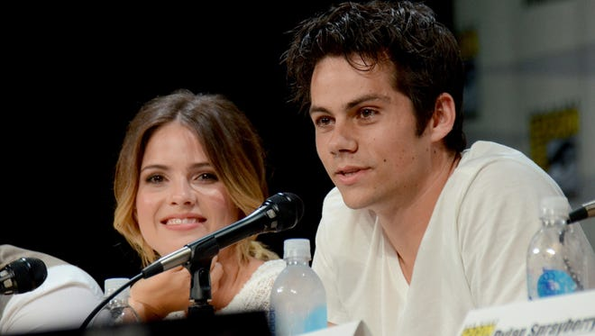 """Shelley Hennig, left, and Dylan O'Brien attend the MTV """"Teen Wolf"""" panel on Day 1 of Comic-Con International on Thursday, July 24, 2014, in San Diego."""