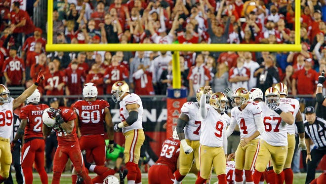 San Francisco 49ers kicker Phil Dawson (9) celebrates his game-winning field goal to beat the Arizona Cardinals 23-20 on Sunday, Dec. 29, 2013 in Glendale.