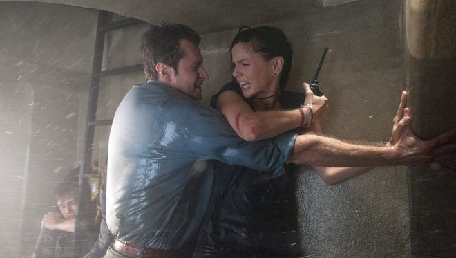 """Richard Armitage, left, and Sarah Wayne Callies brave some pretty nasty weather in """"Into The Storm."""""""