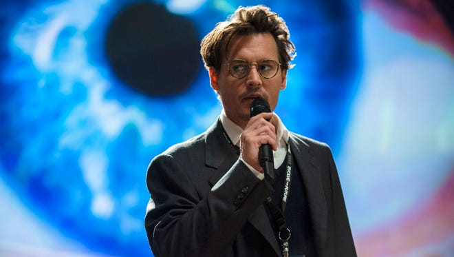 Johnny Depp stars as a doctor who blurs the line between man and machine in the new thriller 'Transcendence.'