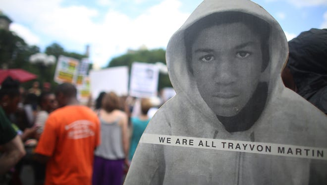 People gather at a rally honoring Trayvon Martin at Union Square in New York City on July 14.