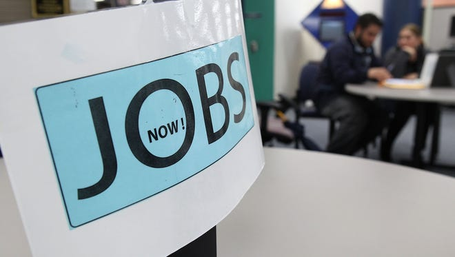 A sign advertising jobs is seen at the Career Link Center One Stop job center in San Francisco.