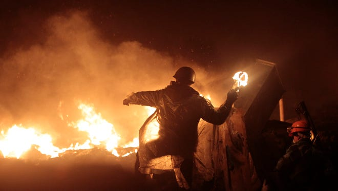 Anti-government protesters clash with riot police in Kiev's Independence Square in Ukraine,  Feb. 20.