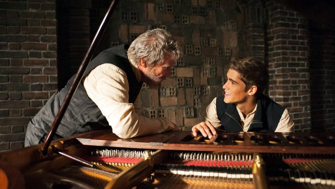"""Jeff Bridges, left, and Brenton Thwaites in a scene from """"The Giver."""""""