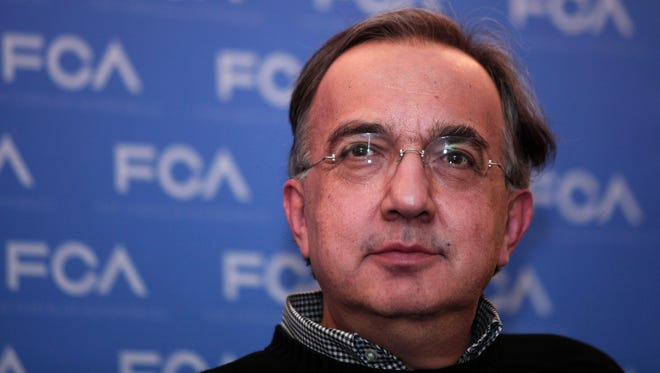 Fiat and Chrysler CEO after presenting the proposed Fiat Chrysler Automobile (FCA) fiver-year plan Plan to investors, analysts, and key stockholders at the company's 2014 Investor Day on May 6 in Auburn Hills, Michigan.