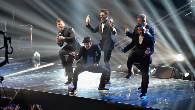 Lance Bass, left, Justin Timberlake, JC Chasez, Joey Fatone and Chris Kirkpatrick, of 'N Sync perform during the 2013 MTV Video Music Awards on Sunday.
