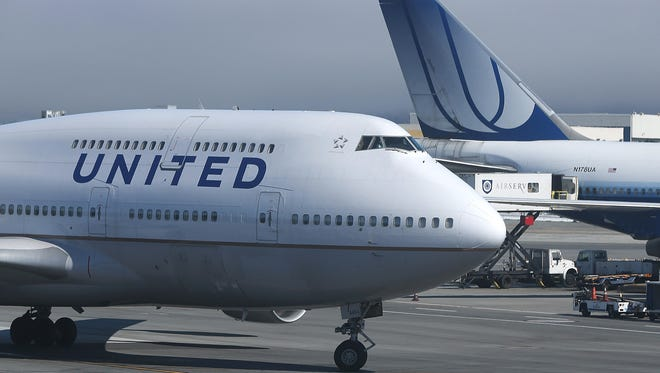 A United Airlines 747 arrives at San Francisco International Airport.