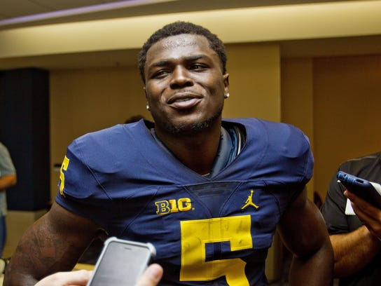 Michigan safety Jabrill Peppers speaks to reporters