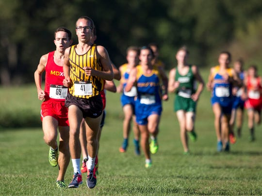 Central's Evan Sorensen (41) and Mater Dei's Adam Babillis (69) placed second and third with respective times of 16:07 and 16:13 during the SIAC cross country meet at Angel Mounds in Evansville, Ind., on Saturday, Sept. 30, 2017.