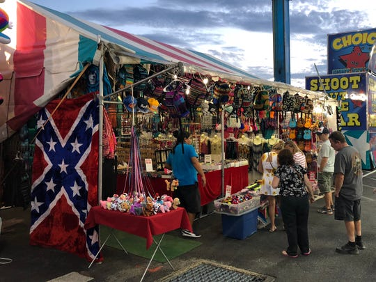 A Confederate flag hangs outside of a vendor booth at the 2018 Delaware State Fair.