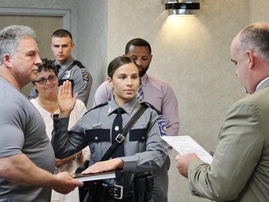 Victoria Raub, 26, of Barnegat, takes the police oath at her swearing-in May 1.
