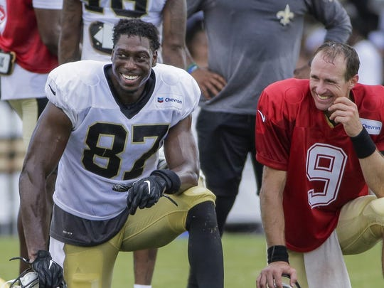 Jul 28, 2019; Metairie, LA, USA; New Orleans Saints tight end Jared Cook (87) and quarterback Drew Brees (9) talk during training camp at the Ochsner Sports Performance Center. Mandatory Credit: Derick E. Hingle-USA TODAY Sports