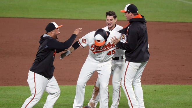 The Baltimore Orioles celebrate Mark Trumbo's game-winning single against the Washington Nationals on Tuesday.