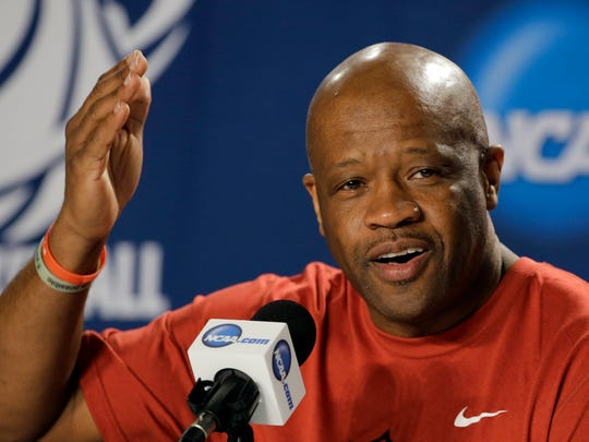 Arkansas head coach Mike Anderson gestures during a news conference at the NCAA college basketball tournament, Friday, March 20, 2015, in Jacksonville, Fla.  Arkansas takes on North Carolina in the Round of 32 on Saturday. (AP Photo/Chris O'Meara)