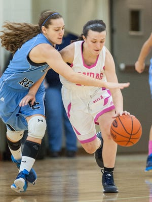 Notre Dame's Jenna Martin beats Boone County's Maleah Hirn to a loose ball during the first quarter.