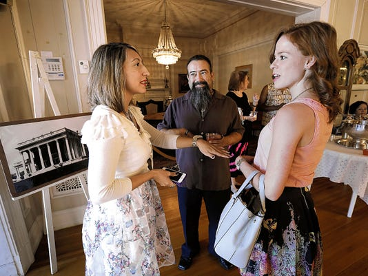 Artist Jaime Santiago Gonzalez Aragon, center, gives a tour of the International Museum of Art to Nikki Martinez, left, and Erin Quigley during the museum's 75th anniversary celebration Thursday.