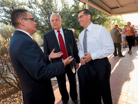 U.S. Rep. Xavier Becerra, D-Los Angeles, right, talks with El Paso District Attorney Jaime Esparza, left, and former Congressman Silvestre Reyes during a reception at the Chamizal National Memorial on Monday. Becerra was in El Paso to speak on behalf of the new Hispanic cultural center being created.