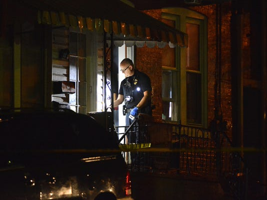 York City Police investigate a fatal shooting in the 300 block of East Cottage Place, Tuesday September 1, 2015. John A. Pavoncello - jpavoncello@yorkdispatch.com
